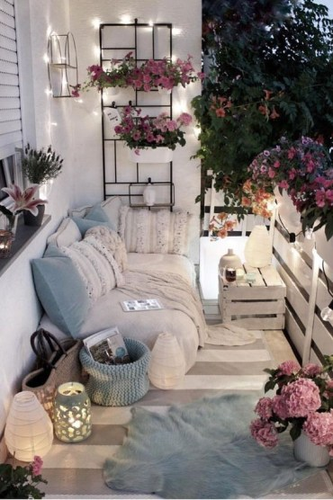 Light-blue-pillows-and-a-basket-potted-pink-flowers-and-some-lights-and-lanterns-will-make-your-balcony-tender-and-spring-like