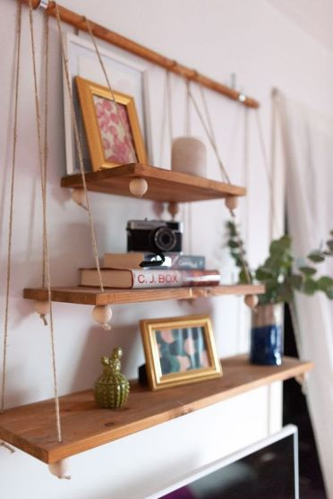 2-12-a-boho-hanging-shelf-composed-of-several-tiers-of-various-sizes-beads-on-a-wooden-holder