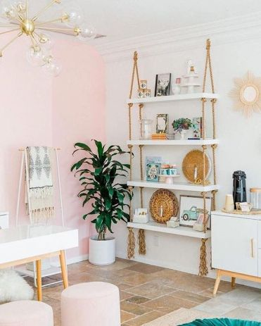 2-15-a-hanging-shelving-unit-with-white-shelves-and-simple-ropes-with-long-fringe-add-a-boho-feel-to-the-glam-space