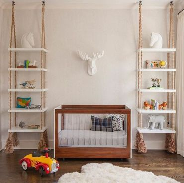 4-25-shelving-units-hanging-on-ropes-with-tassels-on-both-sides-of-the-crib-is-a-cool-idea-that-brings-a-relaxed-feel-to-the-space