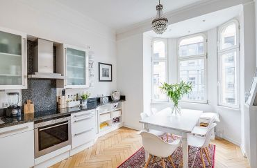 4-white-scandinavian-kitchen-with-a-flood-of-natural-light-and-herringbone-floor