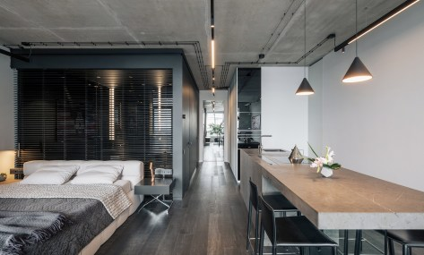 Minimalist apartment with a window overlooking the city 3