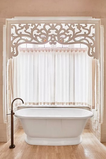 Pink bathroom with stained glass window