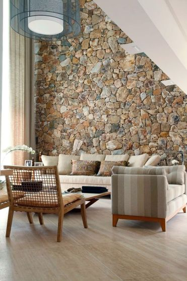 A-rough-stone-accent-wall-adds-a-natural-feel-to-the-contemporary-living-room-and-brings-a-touch-of-natural-color
