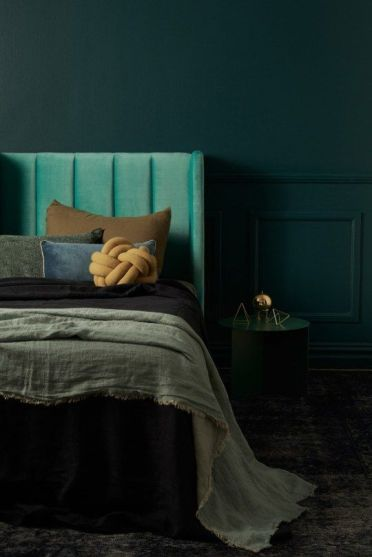 Green-moody-color-palette-with-bold-dark-shades-and-geometric-decorations