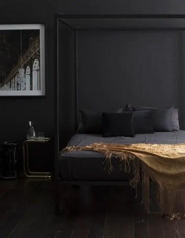 Matte-black-bedroom-with-metallic-details