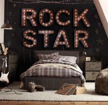 Rock-star-written-in-large-illuminated-decorative-letters-on-a-dark-brown-wall-over-a-brown-bed-featuring-checkered-pillow-cases-and-duvet-cool-beds-for-teens-cream-rug-on-a-light-beige-wooden-floor