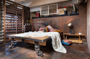 Steel-diamond-plates-make-this-room-super-unusual-but-a-bed-is-still-the-centerpiece