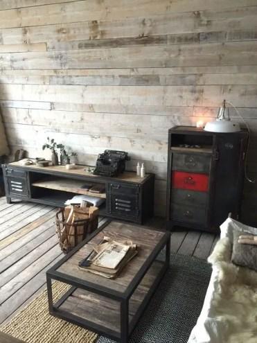 Weathered-wood-floor-and-walls-an-industrial-wood-and-metal-coffee-table-vintage-metal-furniture