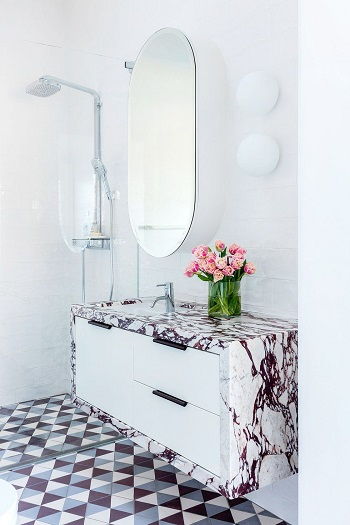 With deep burgundy-pink marble