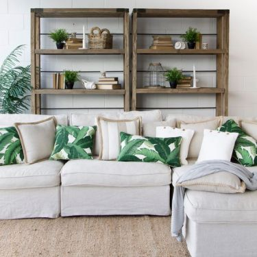 07-mix-usual-pillows-and-tropical-print-ones-to-add-summer-cheer-to-your-living-room