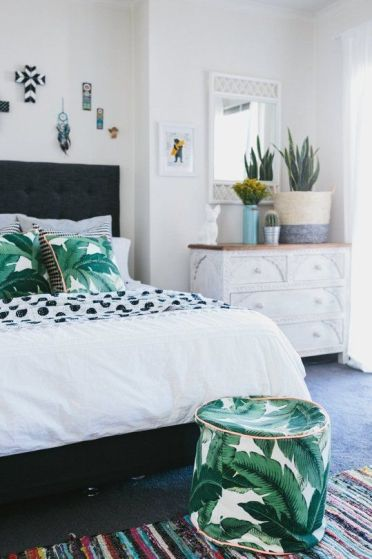 12-tropical-leaf-print-pillows-and-a-matching-ottoman-for-a-summer-bedroom