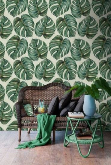 2-15-monstera-leaf-printed-wallpaper-echoes-with-a-green-coffee-table-and-blanket