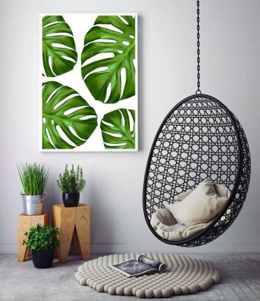 2-24-a-colorful-monstera-leaf-wall-art-echoes-with-the-greenery-below