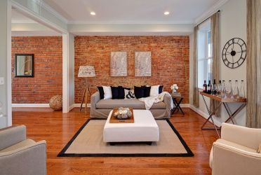 Eclectic-living-room-with-masterful-use-of-the-brick-accent-wall