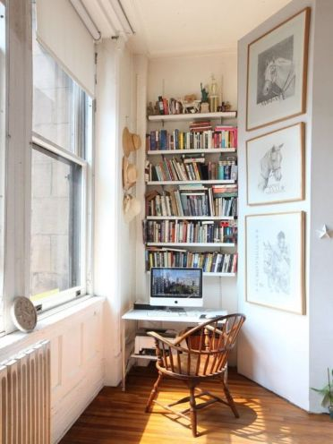 A-small-working-nook-with-built-in-bookshelves-a-small-desk-and-a-vintage-chair-is-a-stylish-eclectic-space-3