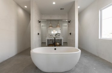 Bathroom-white-standing-tub-rock-the-block