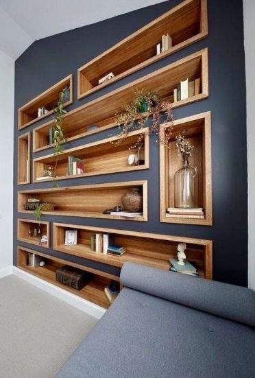 Bookshelves-and-niches-built-into-a-wall-contrast-it-and-make-the-use-of-this-blank-wall-3