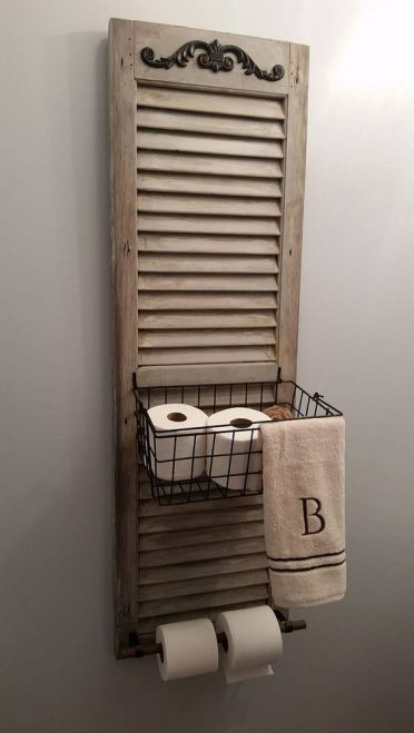06-a-bathroom-shelf-made-of-an-old-shutter-and-a-metal-basket-is-an-easy-diy-project