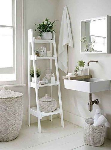 08-a-white-vintage-ladder-for-bathroom-storage-is-a-perfect-idea-for-a-neutral-space