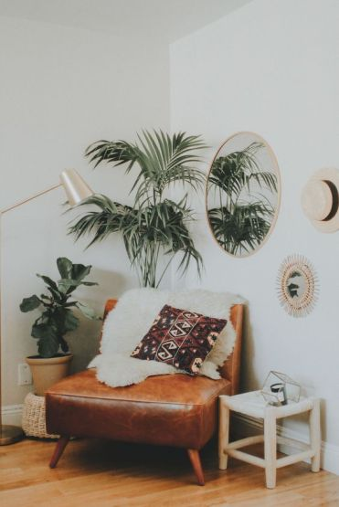 2-02-a-boho-nook-with-a-leather-chair-some-potted-greenery-a-mirror-and-a-lamp-makes-up-a-cozy-reading-space