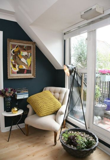 2-04-a-cozy-reading-nook-by-the-window-with-an-artwork-succulents-and-a-small-side-table