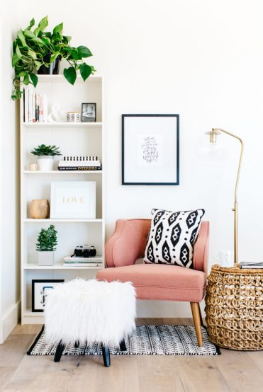 2-05-a-cozy-corner-with-a-pink-armchair-a-floor-lamp-and-some-poufs-is-an-ideal-reading-nook-and-is-very-inviting-775x1164-2