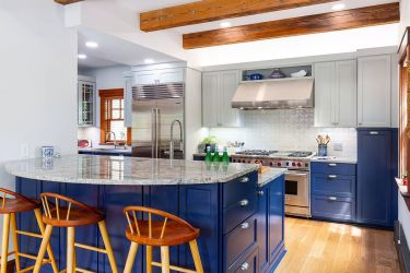 Craftsman-style-kitchen-in-classic-blue-and-white-with-wooden-ceiling-beams