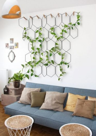 A-grid-attached-to-the-wall-with-a-climbing-plant-is-a-simple-and-very-cool-spring-decoration-you-can-rock
