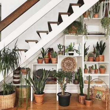 Bohemian-chic-under-stairs-garden-with-shelves-ideas