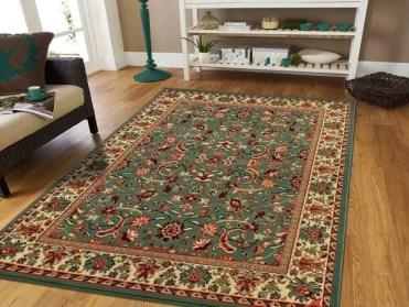 Persian-rug-modern-living-room-wood-flooring-open-shelves-e1536730620307