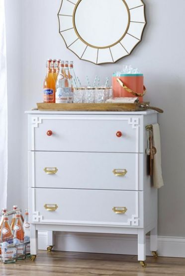 20-a-whimsy-ikea-tarva-hack-in-dove-grey-with-brass-and-red-knobs-plus-white-inlays-and-casters-makes-up-a-cool-home-bar