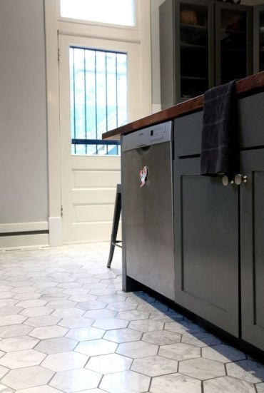 3-32-marble-hex-tile-floors-make-black-cabinets-stand-out