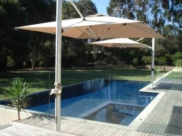 Square-umbrellas-swimming-pool-sun-protection-ideas-patio-design