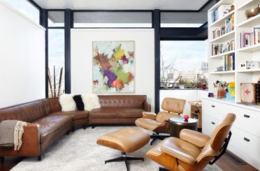 Use-couch-and-seating-in-leather-that-matches-the-eames-lounger