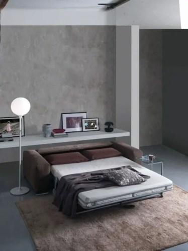 Wohnzimmer-neutrale-farben-ausziehbares-design-teppich-betonwand