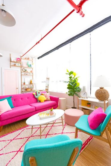 A-colorful-living-room-with-a-pink-sofa-turquoise-chairs-bright-pillows-of-catchy-shapes-for-fun