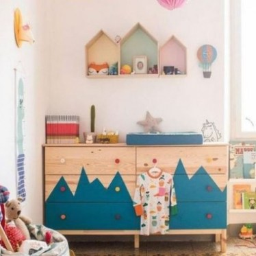 A-double-tarva-dresser-with-a-mountain-inspired-pattern-and-colorful-knobs-for-an-adventure-themed-kids-room