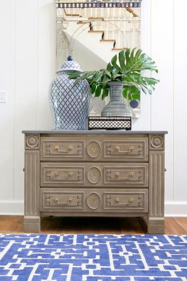 Blue-and-grey-foyer-gray-chest-antiqued-mirror-blue-geometric-rug