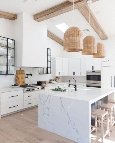 05-a-chic-white-kitchen-with-white-marble-countertops-and-a-backsplash-plus-a-marble-kitchen-island-for-a-refined-feel