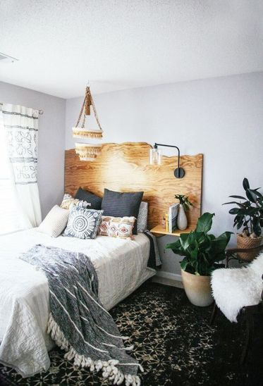 06-a-live-edge-headboard-with-floating-nightstands-and-a-single-lamp-attached-is-a-cool-idea-with-a-boho-feel