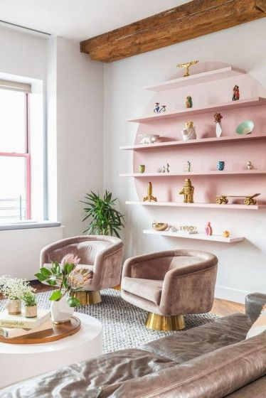 1-10-a-pastel-living-room-with-a-pink-open-shelving-unit-refined-taupe-furniture-and-potted-blooms-and-greenery