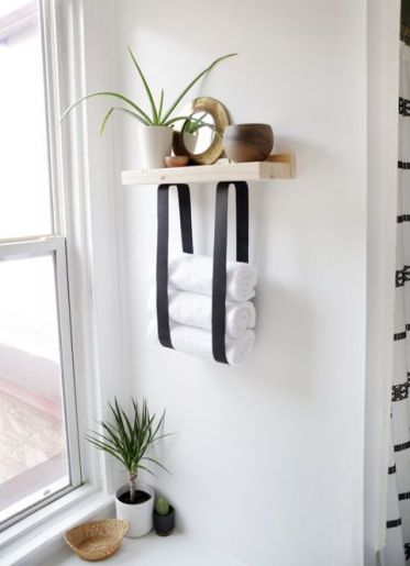 13-a-wood-and-leather-strap-towel-shelf-will-let-you-store-not-only-towels-but-also-decor-and-accessories