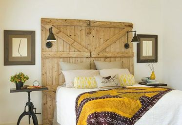 18-a-barn-door-used-as-a-headboard-in-this-bright-bedroom-features-lamps-and-add-a-cozy-rustic-touch