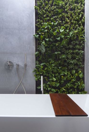 2-a-minimalist-bathroom-clad-with-concrete-and-with-a-living-wall-that-is-a-fresh-and-cool-statement-for-lively-decor