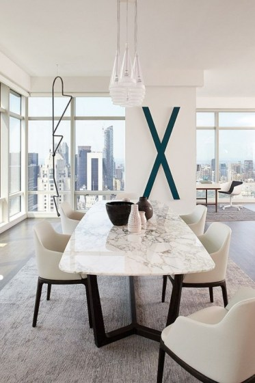 23-a-contemporary-luxurious-dining-table-with-a-black-base-and-a-white-marble-tabletop-for-ultimate-chic
