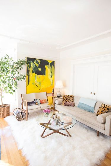 Shabby-chic-accents-coupled-with-a-bright-pop-of-yellow-in-the-cozy-white-living-room-96482