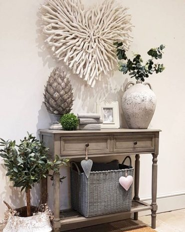 A-large-heart-wall-decor-made-of-whitewashed-driftwood-branches-is-a-cool-beach-and-coastal-idea