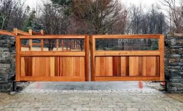 Cedar-wood-driveway-gate-ideas-with-stone-columns