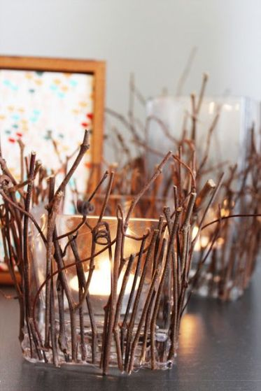 Square-glass-candleholders-covered-with-twigs-and-sticks-are-cool-decorations-that-bring-coziness-to-the-space